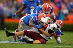 Florida Gators Bryon Cox Jr and Jalen Tabor combine for the tackle on Eastern Kentucky wide receiver Scott Daniel in the third quarter.  Florida Gators vs Miami Hurricanes.  November 17th, 2014. Gator Country photo by David Bowie.