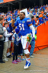 Florida Gators linebacker Michael Taylor runs out onto the field during senior day introductions.  Florida Gators vs Eastern Kentucky Colonels.  November 22th, 2014. Gator Country photo by David Bowie.