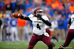 Eastern Kentucky quarterback Bennie Coney throws downfield.  Florida Gators vs Eastern Kentucky Colonels.  November 22th, 2014. Gator Country photo by David Bowie.