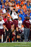 EKU tight end Caleb Hodgson leaps into the air for a catch in the second quarter.  Florida Gators vs Eastern Kentucky Colonels.  November 22th, 2014. Gator Country photo by David Bowie.