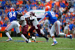 EKU quarterback Bennie Coney scrambles looking downfield for an open receiver during the first quarter.  Florida Gators vs Eastern Kentucky Colonels.  November 22th, 2014. Gator Country photo by David Bowie.