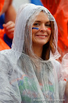 A soaking wet gator fan smiles on as she watches the Gators dominate the afternoon.  Florida Gators vs Eastern Kentucky Colonels.  November 22th, 2014. Gator Country photo by David Bowie.