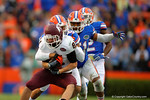 Florida Gators linebacker Michael Taylor and Florida Gators defensive back Jalen Tabor combine for a tackle in the third quarter on EKU wide receiver Scott Daniel.  Florida Gators vs Eastern Kentucky Colonels.  November 22th, 2014. Gator Country photo by David Bowie.