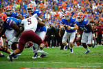 Florida Gators quarterback Jeff Driskel rushes into the endzone for a touchdown in the second quarter.  Florida Gators vs Eastern Kentucky Colonels.  November 22th, 2014. Gator Country photo by David Bowie.
