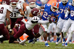 Florida Gators running back Adam Lane Jr rushes downfield in the fourth quarter being tackled by EKU linebacker Blake Atzinger.  Florida Gators vs Eastern Kentucky Colonels.  November 22th, 2014. Gator Country photo by David Bowie.