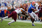 Florida Gators wide receiver Latroy Pittman tries to avoid the tackle of an EKU defender in third quarter.  Florida Gators vs Eastern Kentucky Colonels.  November 22th, 2014. Gator Country photo by David Bowie.