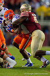Florida Gators running back Kelvin Taylor is tackled by FSU linebacker Reggie Northrup in the third quarter.  Florida Gators vs FSU Seminoles.  November 22th, 2014. Gator Country photo by David Bowie.
