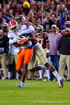 Florida Gators wide receiver Quinton Dunbar is tackled after making a catch in the third quarter.  Florida Gators vs FSU Seminoles.  November 22th, 2014. Gator Country photo by David Bowie.
