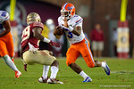 Florida Gators quarterback Treon Harris rushes downfield during the third quarter.  Florida Gators vs FSU Seminoles.  November 22th, 2014. Gator Country photo by David Bowie.