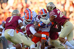 Florida Gators running back Kelvin Taylor is met by the FSU defense during the first quarter.  Florida Gators vs FSU Seminoles.  November 22th, 2014. Gator Country photo by David Bowie.