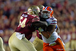 Florida Gators defensive lineman Jonathan Bullard is double teamed by the FSU defense during the third quarter.  Florida Gators vs FSU Seminoles.  November 22th, 2014. Gator Country photo by David Bowie.