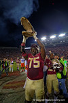 FSU offensive lineman Cameron Erving lifts a gator head into the air in celebration following the Seminoles victory.  Florida Gators vs FSU Seminoles.  November 22th, 2014. Gator Country photo by David Bowie.