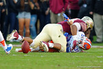Florida Gators wide receiver Mike McNeely is tackled as he was going for a fumbled punt attempt by FSU in the second quarter.  Florida Gators vs FSU Seminoles.  November 22th, 2014. Gator Country photo by David Bowie.