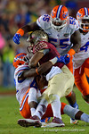 Florida Gators defensive back Keanu Neal and Florida Gators defensive tackle Darius Cummings combine for the a tackle on FSU quarterback Jameis Winston during the third quarter.  Florida Gators vs FSU Seminoles.  November 22th, 2014. Gator Country photo by David Bowie.