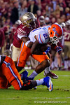FSU defensive back Tyler Hunter tackles Florida Gators running back Kelvin Taylor in the third quarter.  Florida Gators vs FSU Seminoles.  November 22th, 2014. Gator Country photo by David Bowie.