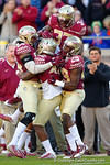 FSU safety Lamarcus Brutus is congratulated by his team mates after his interception.  Florida Gators vs FSU Seminoles.  November 22th, 2014. Gator Country photo by David Bowie.