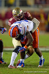FSU linebacker Terrance Smith tackles Florida Gators running back Kelvin Taylor in the third quarter.  Florida Gators vs FSU Seminoles.  November 22th, 2014. Gator Country photo by David Bowie.