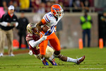 Florida Gators wide receiver Demarcus Robinson is tackled by FSU defensive back P.J. Williams in the third quarter.  Florida Gators vs FSU Seminoles.  November 22th, 2014. Gator Country photo by David Bowie.