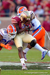 FSU running back Karlos Williams is tackled by Gators Marcus Maye and Brian Poole in the second quarter.  Florida Gators vs FSU Seminoles.  November 22th, 2014. Gator Country photo by David Bowie.