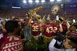 Florida State celebrates after the game by lifting a gatpr head into the air.  Florida Gators vs FSU Seminoles.  November 22th, 2014. Gator Country photo by David Bowie.