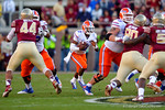 Florida Gators quarterback Treon Harris keeps the ball and rushes up the middle during the second quarter.  Florida Gators vs FSU Seminoles.  November 22th, 2014. Gator Country photo by David Bowie.