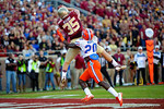 FSU tight end Nick O'Leary leaps into the air over Florida Gators defensive back Marcus Maye for his first of two touchdowns on the day.  Florida Gators vs FSU Seminoles.  November 22th, 2014. Gator Country photo by David Bowie.