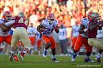 Florida Gators running back Kelvin Taylor rushes up the middle during the first quarter.  Florida Gators vs FSU Seminoles.  November 22th, 2014. Gator Country photo by David Bowie.