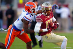 Florida Gators defensive back Brian Poole tackles FSU wide receiver Rashad Greene during the second quarter.  Florida Gators vs FSU Seminoles.  November 22th, 2014. Gator Country photo by David Bowie.