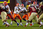 Florida Gators quarterback Treon Harris hands the ball off to Florida Gators running back Kelvin Taylor during the third quarter.  Florida Gators vs FSU Seminoles.  November 22th, 2014. Gator Country photo by David Bowie.