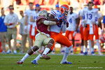 Florida Gators wide receiver Latroy Pittman is hit after making a catch in the first quarter.  Florida Gators vs FSU Seminoles.  November 22th, 2014. Gator Country photo by David Bowie.
