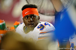 Florida Gators defensive lineman Bryan Cox, Jr. waits on the bench while the offense takes the field during the fourth quarter.  Florida Gators vs FSU Seminoles.  November 22th, 2014. Gator Country photo by David Bowie.