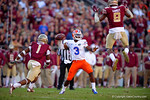 Florida Gators quarterback Treon Harris throws over a leaping FSU defender.  Florida Gators vs FSU Seminoles.  November 22th, 2014. Gator Country photo by David Bowie.