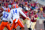 FSU quarterback Jameis Winston throws downfield during the second quarter.  Florida Gators vs FSU Seminoles.  November 22th, 2014. Gator Country photo by David Bowie.