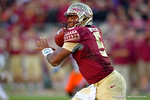 FSU quarterback Jameis Winston looks downfield for an open receiver during the second quarter.  Florida Gators vs FSU Seminoles.  November 22th, 2014. Gator Country photo by David Bowie.