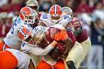 Florida Gators defensive lineman Alex McCallister tackles FSU running back Karlos Williams in the second quarter.  Florida Gators vs FSU Seminoles.  November 22th, 2014. Gator Country photo by David Bowie.