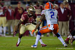 FSU running back Mario Pender cuts back to avoid a tackle by Florida Gators defensive back Jabari Gorman in the fourth quarter.  Florida Gators vs FSU Seminoles.  November 22th, 2014. Gator Country photo by David Bowie.
