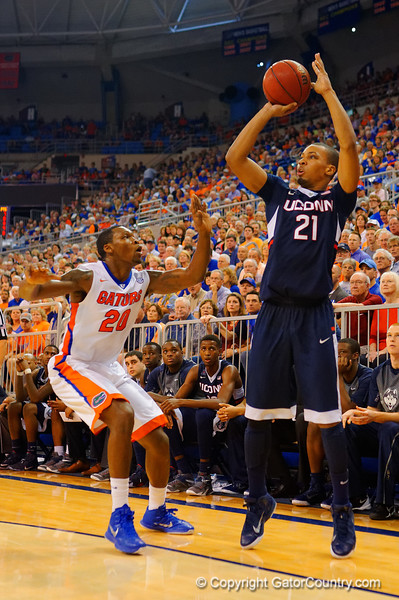 UCONN Huskies guard Omar Calhoun launches a three pointer from the corner during the second half.  Florida Gators vs UCONN Huskies.  January 3rd, 2015. Gator Country photo by David Bowie.