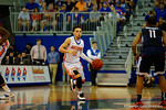 Florida Gators guard Chris Chiozza dribbles up court during the first half.  Florida Gators vs UCONN Huskies.  January 3rd, 2015. Gator Country photo by David Bowie.