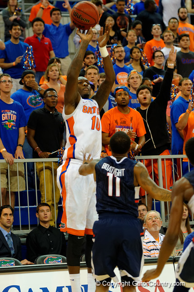 Florida Gators forward Dorian Finney-Smith drains a three point basket during the first half.  Florida Gators vs UCONN Huskies.  January 3rd, 2015. Gator Country photo by David Bowie.
