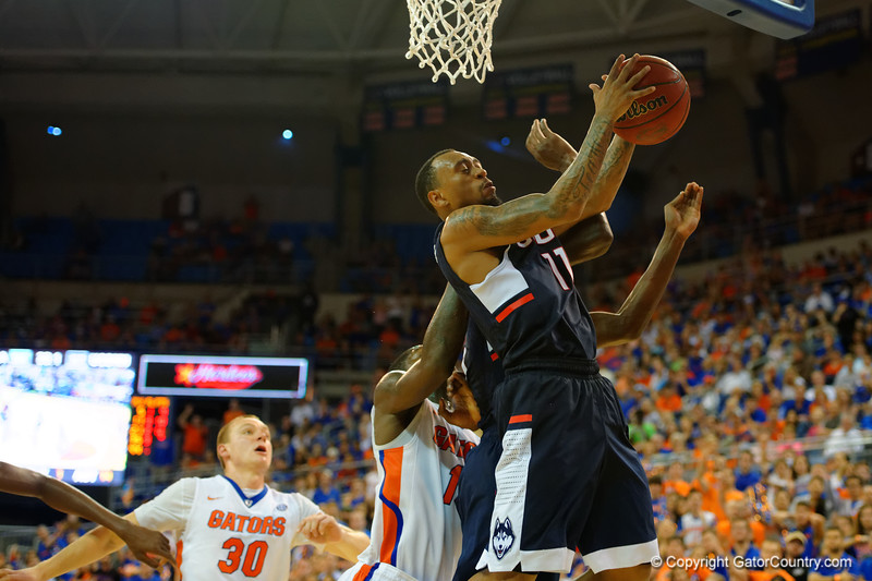 UCONN Huskies guard Ryan Boatright leaps up for a rebound late in the second half.  Florida Gators vs UCONN Huskies.  January 3rd, 2015. Gator Country photo by David Bowie.