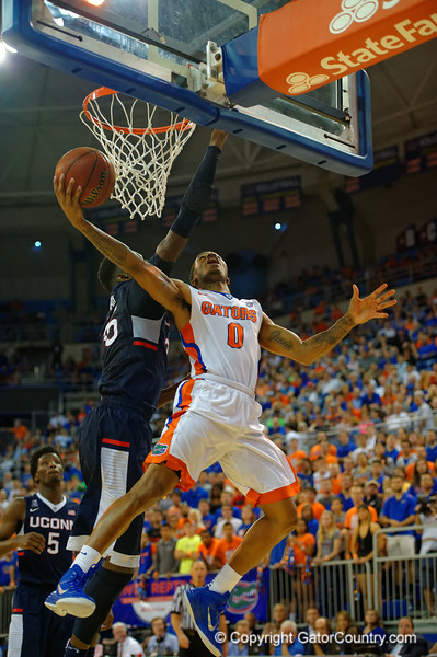 Florida Gators guard Kasey Hill with a reverse layup during the second half.  Florida Gators vs UCONN Huskies.  January 3rd, 2015. Gator Country photo by David Bowie.