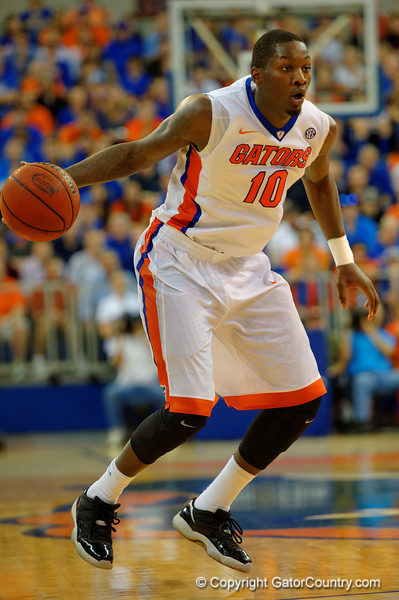 Florida Gators forward Dorian Finney-Smith dribbling during the second half.  Florida Gators vs UCONN Huskies.  January 3rd, 2015. Gator Country photo by David Bowie.
