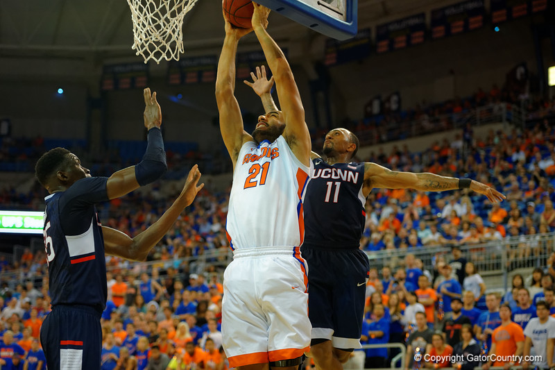 Florida Gators center Jon Horford leaps for a dunk attempt during the second half.  Florida Gators vs UCONN Huskies.  January 3rd, 2015. Gator Country photo by David Bowie.