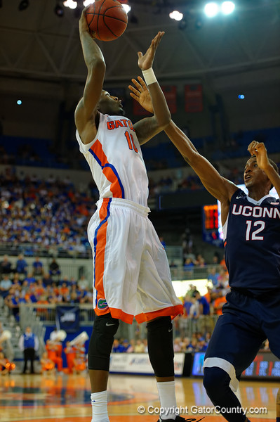 Florida Gators forward Dorian Finney-Smith shoots during the second half.  Florida Gators vs UCONN Huskies.  January 3rd, 2015. Gator Country photo by David Bowie.