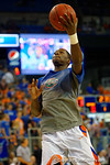 Florida Gators forward Dorian Finney-Smith lays in the ball during pre-game drills.  Florida Gators vs UCONN Huskies.  January 3rd, 2015. Gator Country photo by David Bowie.