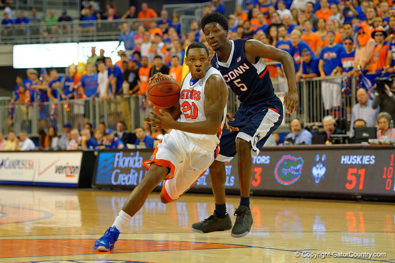 Florida Gators guard Michael Frazier II dribbles toward the basket during the second half.  Florida Gators vs UCONN Huskies.  January 3rd, 2015. Gator Country photo by David Bowie.