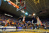 Florida Gators guard Kasey Hill leaps with a shot attempt during the first half.  Florida Gators vs UCONN Huskies.  January 3rd, 2015. Gator Country photo by David Bowie.