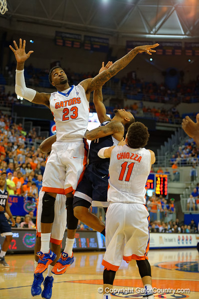 Florida Gators forward Chris Walker leaps for a rebound during the second half.  Florida Gators vs UCONN Huskies.  January 3rd, 2015. Gator Country photo by David Bowie.