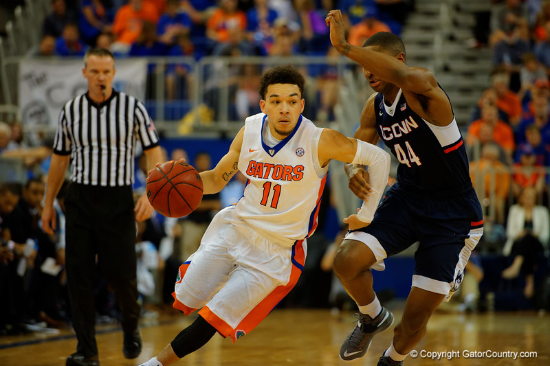 Florida Gators guard Chris Chiozza dribbles down court being guarded by UCONN Huskies guard Rodney Purvis during the second half.  Florida Gators vs UCONN Huskies.  January 3rd, 2015. Gator Country photo by David Bowie.