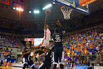 Florida Gators forward Dorian Finney-Smith posterizes UCONN Huskies guard Terrence Samuel during the second half.  Florida Gators vs UCONN Huskies.  January 3rd, 2015. Gator Country photo by David Bowie.